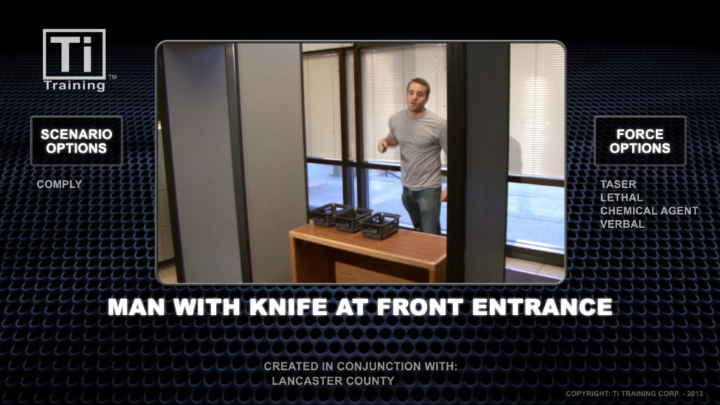 man wiht a knife at front entrance